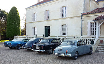 Old cars inside Domaine Tesseron